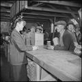 Manzanar Relocation Center, Manzanar, California. An elderly evacuee purchases peanut butter for a . . . - NARA - 536927.tif