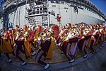 Marching band performs during a Battle of the Bands competition beside the amphibious assault ship USS Essex 141226-N-GM561-083.jpg