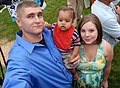 Marine Cpl. Jonathon Fortune, his wife Kyrie and son Carson enjoy the Independence Day 2009.jpg