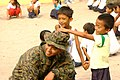 Marine plays a game with children (4435472878).jpg
