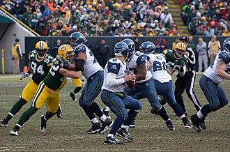 Forward pass - Matt Hasselbeck (8) of Seattle Seahawks dropping back to pass against Green Bay Packers in 2009