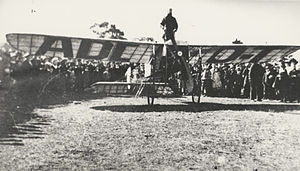 Maurice Guillaux - Guillaux standing on top of his plane at Wangaratta, partway through the trip