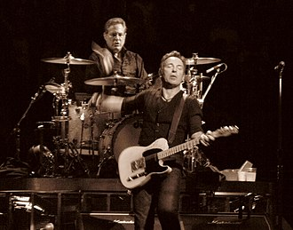 Max Weinberg - During his tenure with the E Street Band, Weinberg's gaze remains locked on Springsteen throughout each show.