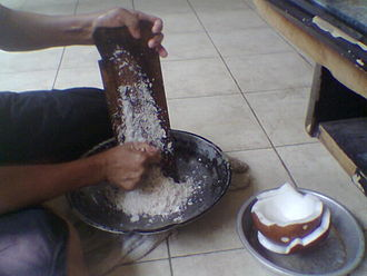 Coconut milk - The traditional method of grating coconut flesh to acquire fresh coconut milk