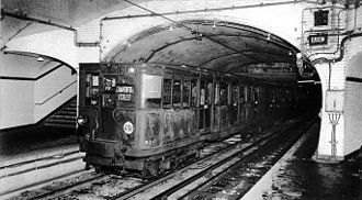 Paris Métro Line 8 - Old Metro train pulling into the new Charenton – Écoles station around 1943