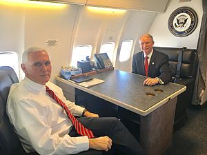 John Rutherford (Florida politician) - Rutherford meeting with Vice President Mike Pence on board Air Force Two, March 2017