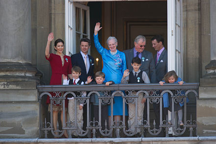 The Queen surrounded by her family waving to crowds on her 70th birthday in April 2010. From left to right: the Crown Princess, Prince Felix, the Crown Prince, Prince Christian, the Queen, Prince Nikolai, Prince Consort Henrik, Prince Joachim and Princess Isabella Monarchy Of Denmark April 2010.jpg