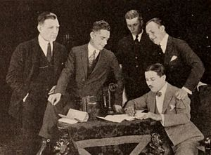 Frank Griffin (director) - For the signing of Monty Banks with Warner Bros., Frank Griffin was second from the left
