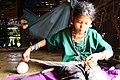 Mru girl weaving in a traditional home.jpg