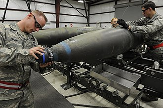 Munitions Systems Specialist (U.S. Air Force) - Munitions Systems specialists assigned to the 388th Munitions Squadron assemble a GBU-31 joint direct attack munition at Hill Air Force Base, Utah, 2011.