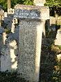 Nadgrobni spomenik sa svastikom i drugim solarnim simbolima.jpg