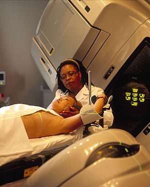 Radiation therapist - A woman is being prepared for radiation therapy by a radiation therapist.