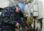 Nimitz Sailor inspects conflag station 151123-N-UM507-024.jpg