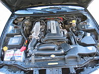 Nissan 200SX S14a Engine Bay Stock.JPG