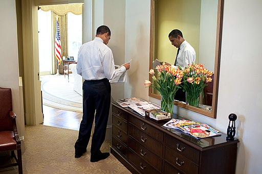 Obama reading newspaper