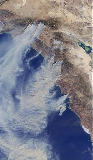 2003 California wildfires - Satellite view of the October 2003 wildfires in Southern California, depicting the smoke blowing out over the Pacific Ocean.