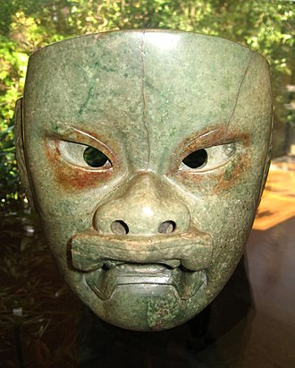 Olmec alternative origin speculations - Olmec jadeite masks. Facial features such as almond-shaped eyes (supposed feature of Chinese origin) and prominent lips (supposed feature of African origin) are sometimes forwarded as proof by supporters of alternative origins. Both almond-shaped eyes and snarled mouths are characteristic of the were-jaguar motif common in Olmec art.