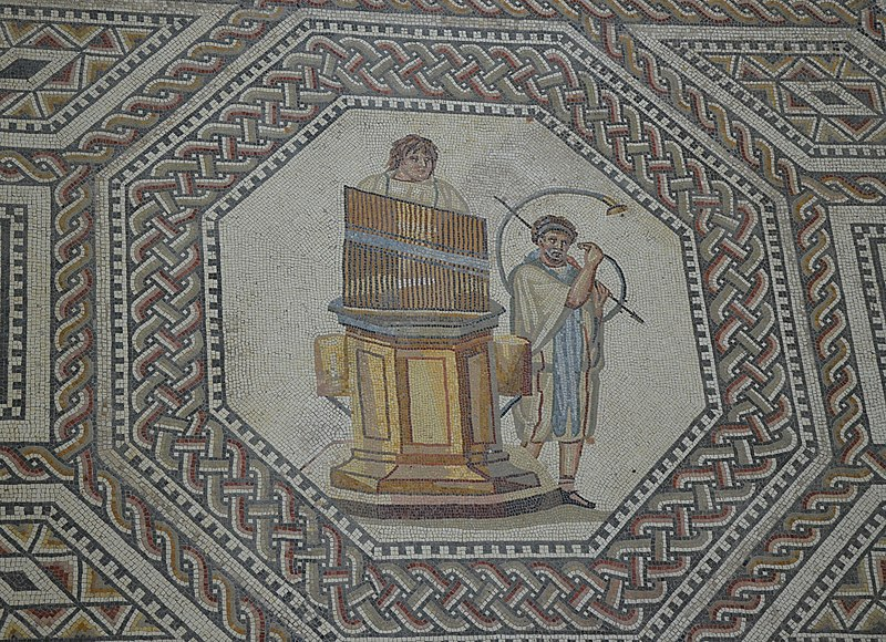 File:Organist and horn player, the gladiator mosaic at the Roman villa in Nennig, Germany (9291661708).jpg