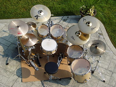 A seven-piece kit typically used for heavy metal and progressive rock, consisting of double bass drums, two floor toms, and an extended set of cymbals (three crashes with splash and China-type). OutsideBRX-15.JPG