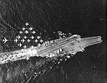 Overhead view of USS Constallation (CVA-64) underway, in the early 1970s (NNAM.1996.488.103.054).jpg