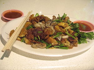 Oyster omelette - Oyster omelette and chili sauce from Newton Food Centre, Singapore.
