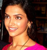 Deepika Padukone is smiling away from the camera