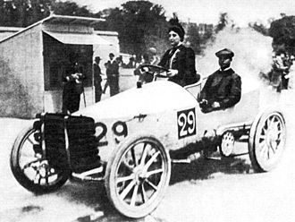 Camille du Gast - Paris–Madrid 1903 – Camille du Gast pilots her 30 hp De Dietrich, with starting number 29. Her upright seating position has been ascribed to the corsetry that the fashion of the time demanded.