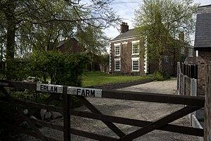 Partington - Erlam Farm is a Grade II listed building.