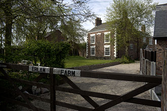 Partington - Erlam Farm is a Grade II listed building.