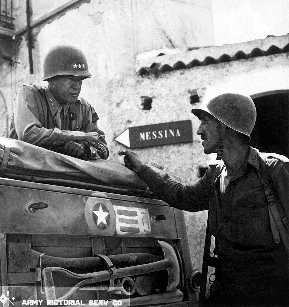 Patton speaking with Lt. Col. Lyle Bernard, at Brolo, circa 1943