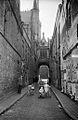 People in Blinde-Ezelstraat (Rue Juvée) street, Bruges, Belgium (7675621394).jpg