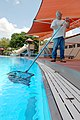 Phillip Sparks, a maintenance worker with the U.S. Air Force 12th Services Division, skims the center pool in preparation for the summer swimming season at Randolph Air Force Base, Texas, May 8, 2007 070508-F-LR258-122.jpg