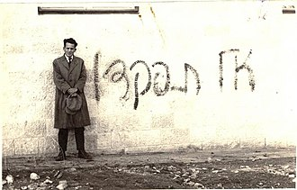 1931 census of Palestine - Abba Ahimeir stands next to graffiti that call not to take part at the 1931 census of Palestine