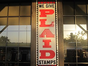 Trading stamp - Plaid Stamps sign at Cracker Barrel restaurant in Lubbock, Texas