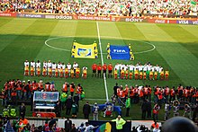 Players and Fans Stand for National Anthems.jpg