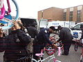 Police officers unload bicycles donated to the Toys for Tots program 131217-N-CG900-004.jpg