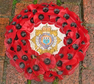 The Royal British Legion - A wreath of artificial poppies featuring the Royal Logistics Corps emblem used on Remembrance Day