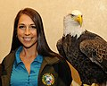 Posing for picture with Bald Eagle. (10596374393).jpg