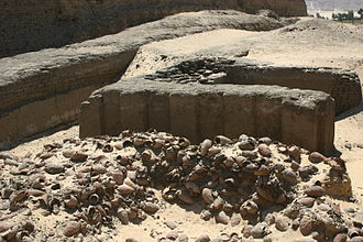 Seth-Peribsen - Peribsen's tomb at Abydos, in the background the Great Enclosure of king Khasekhemwy is visible
