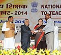 Pranab Mukherjee presenting the National Award for Teachers-2014 to Shri Romesh Singh, Jammu & Kashmir, on the occasion of the 'Teachers Day', in New Delhi. The Union Minister for Human Resource Development.jpg