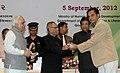 Pranab Mukherjee presenting the National ICT Award for School Teacher-2010 to Shri Santosh Kumar Bisen, Jawahar Navodaya Vidyalaya, on the occasion of the 'Teachers Day'.jpg