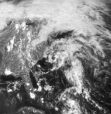 Satellite image of a sprawling, disorganized area of clouds along the East Coast of the United States.