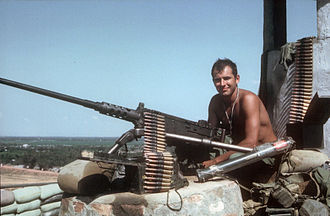 Company E, 52nd Infantry (LRP) (United States) - January 27, 1968. 1st Cav LRP, Sgt. Douglas Parkinson, manning an M2 .50 atop the water tower at LZ Betty.