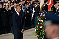 President Barack Obama, left foreground, pauses before a wreath he placed at the Tomb of the Unknowns at Arlington National Cemetery in Arlington, Va., during a Veterans Day wreath-laying ceremony Nov. 11 131111-D-DB155-008.jpg