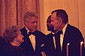 President Bill Clinton and former President George H. W. Bush visit with former First Lady Lady Bird Johnson at the 200th Anniversary of the White House.jpg