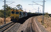 QR electric loco 3136 (in Bicentennial paint scheme) on the Goonyella line, ~1991.jpg