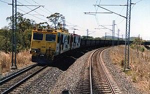 Goonyella railway line - QR electric loco 3136 (in Bicentennial paint scheme) on the Goonyella line