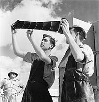 RAF photographers inspect a developed reconnaissance film at a landing ground in Egypt, September 1941. ME(RAF)2402.jpg