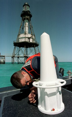 Radar beacon (racon) - A United States Coast Guard technician prepares a racon for installation at Fowey Rocks Light southeast of Miami.