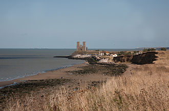Reculver - Reculver viewed from the cliff-top in the country park in 2009: until the late 18th century the centre of Reculver village was slightly left of centre in the area shown.